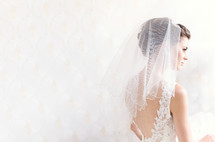 A bride wearing her wedding veil.