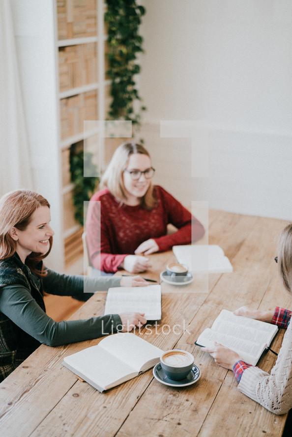 women reading Bibles at a fall Bible study
