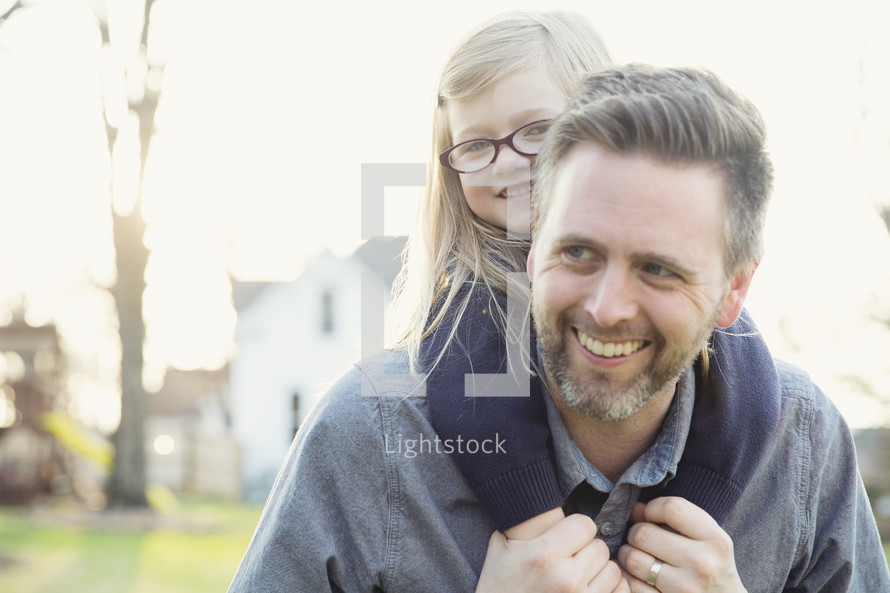 father and daughter together outdoors