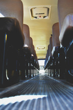 rows of seats on a school bus