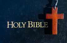 Holy Bible and wooden cross necklace