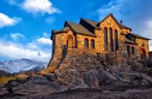 church built into rock on a mountainside
