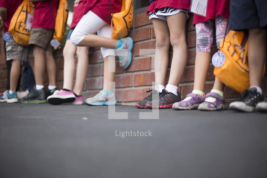 children waiting in a line