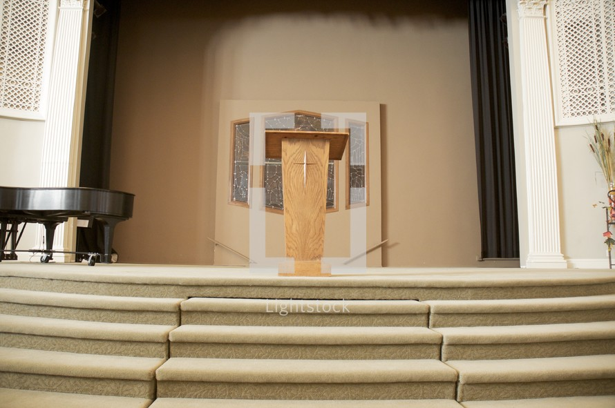 grand piano and podium at the altar