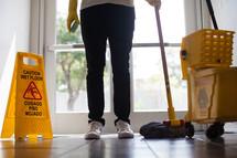 a man cleaning a church lobby