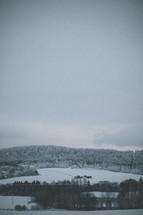 distant farmhouse in the snow