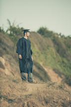 graduate standing outdoors