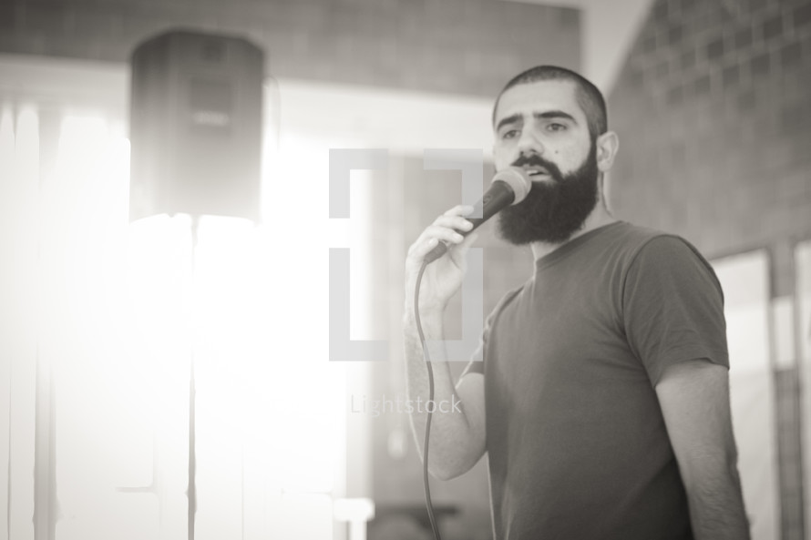 a man speaking into a microphone