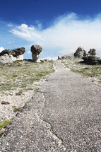 paved path and rock formations