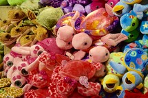display stuffed animal toys in a store