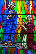 kneeling to Mother Mary stained glass window