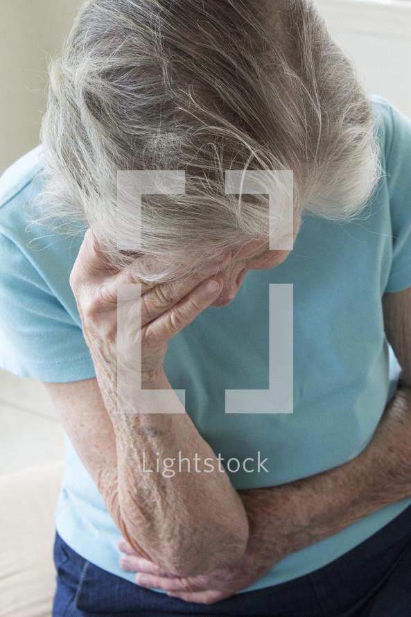 grieving elderly woman