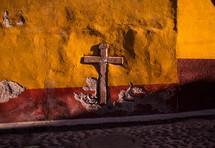 a cross embedded in a wall