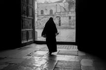 a muslim woman walking in Jerusalem