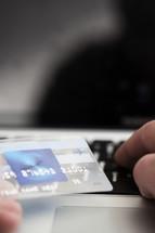 person entering credit card information online.
