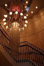 chandelier and stairway