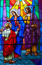 stained glass window of Mary, Joseph, and young Jesus