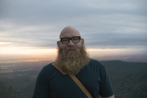 man with a heavy beard standing outdoors