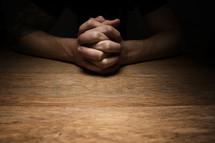 interlaced praying hands