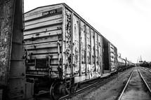 Box cars on a railroad track.