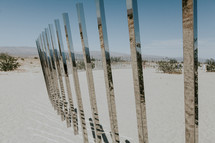 reflection of desert landscape in mirrored glass