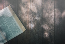 open Bible on a wood background