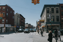 pedestrians and traffic on downtown streets