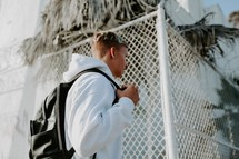 teen walking with a backpack