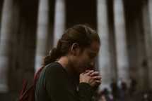 a young woman in prayer