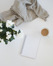 flowers, notebook, linen fabric, and coffee mug
