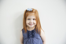portrait of a cute red-headed little girl.