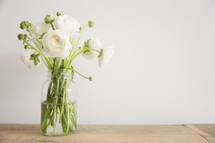 white flowers in a vase on a table