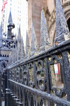 wrought iron fence in front of a church