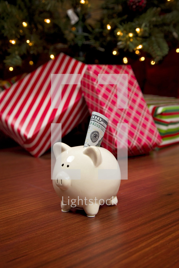 cash in front of a Christmas tree