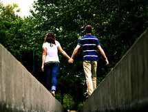 couple balancing walking holding hands