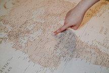 finger pointing to a map