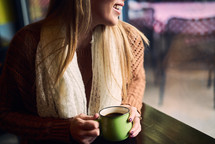 a woman holding a coffee cup