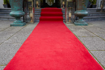 rolled out red carpet leading to a doorway.