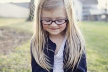 blonde little girl in reading glasses
