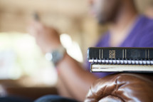 man on cellphone and a Bible - distraction