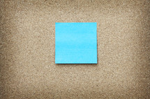 Sticky Note with Copy Space on Cork Board Background
