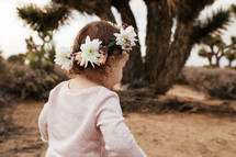 a toddler girl with flowers in her hair