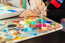 a paint pallet and paint brush