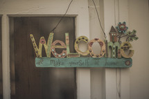 A welcome sign on a window