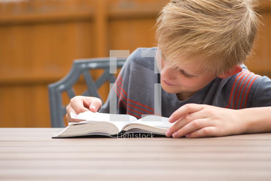 boy reading a Bible