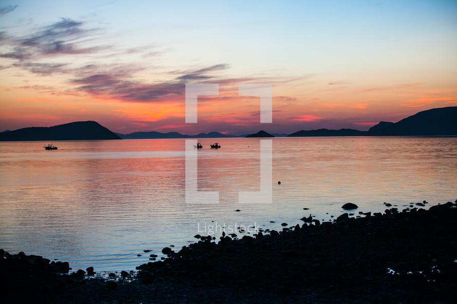 island sunrise over fisherman