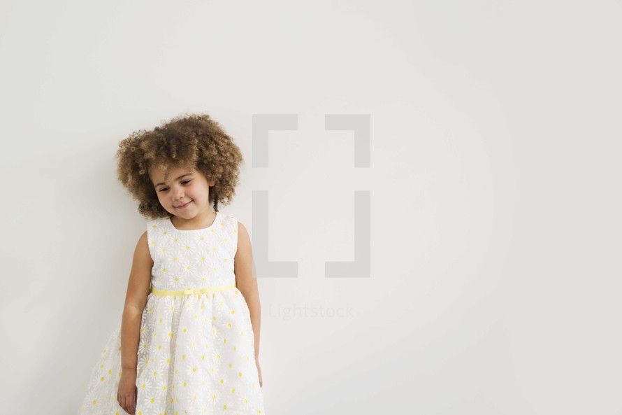 girl child in a dress looking down