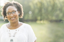 African-American woman's smiling face standing outdoors