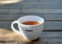 coffee cup with the word happy