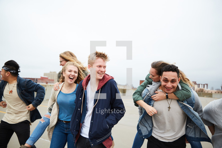 group of teens walking through a parking deck